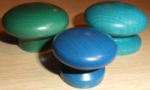 Bright coloured wooden cupboard knobs in forest green, marine blue and peacock blue